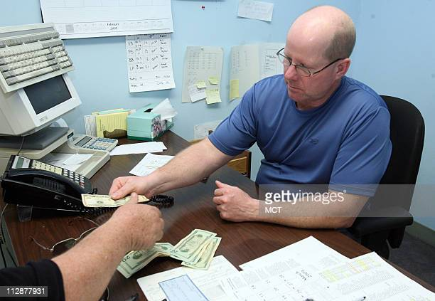 Debt collectors such as Jim Coy seen here March 27 collecting a payment must use tact when dealing with debtors Coy coowns Elite Financial Services...