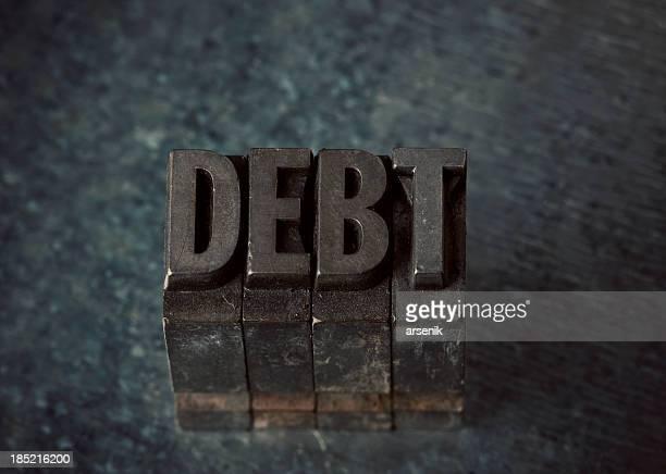 Debt In Letterpress Type