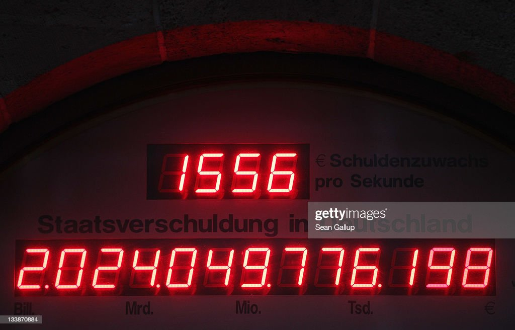 A 'debt meter,' ostensibly showing the current level of the German national debt, reads over EUR 2 trillion over the entrance to the Federation Of Tax Payers on November 21, 2011 in Berlin, Germany. According to the meter Germany's debt level is rising at a rate of EUR 1,556 per second. Germany is, however, perceived by markets as financially stable and the German government pays among the lowest interest rates in Europe to borrow money.