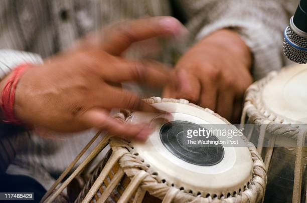 Debu Nayak plays the tabla instrument for an audience in a Silver Spring house basement on May 28 2011 STYLE Photos for a Mark jenkins story on House...