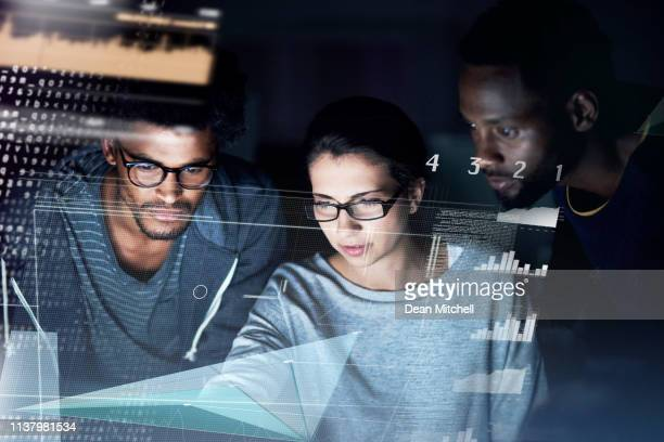 debugging during the dark hours - digital enhancement stock pictures, royalty-free photos & images