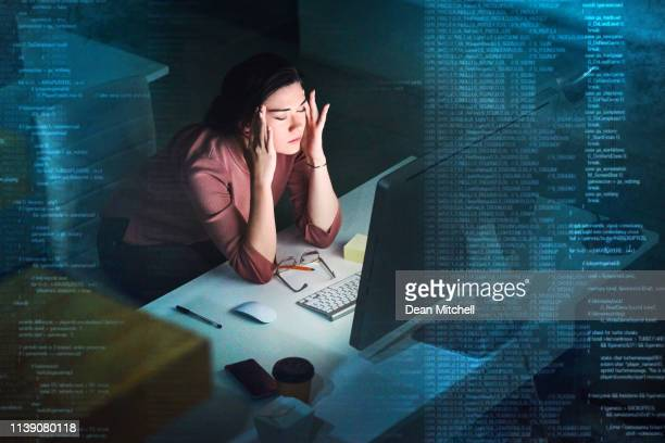 debugging during the dark hours - overworked stock pictures, royalty-free photos & images