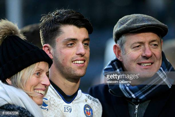 Debutant Adam Hastings of Bath Rugby is greeted by his mother Diane Hastings who suffers with Parkinsons disease and father Gavin Hastings following...