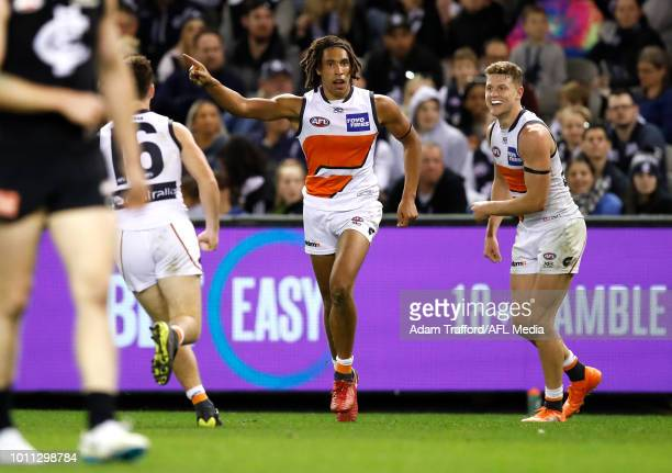 Debutant Aiden Bonar of the Giants celebrates his second AFL goal during the 2018 AFL round 20 match between the Carlton Blues and the GWS Giants at...