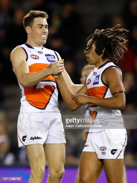 Debutant Aiden Bonar of the Giants celebrates his second AFL goal with Jeremy Cameron of the Giants during the 2018 AFL round 20 match between the...