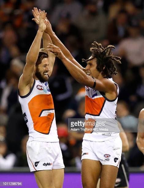 Debutant Aiden Bonar of the Giants celebrates his second AFL goal with Callan Ward of the Giants during the 2018 AFL round 20 match between the...