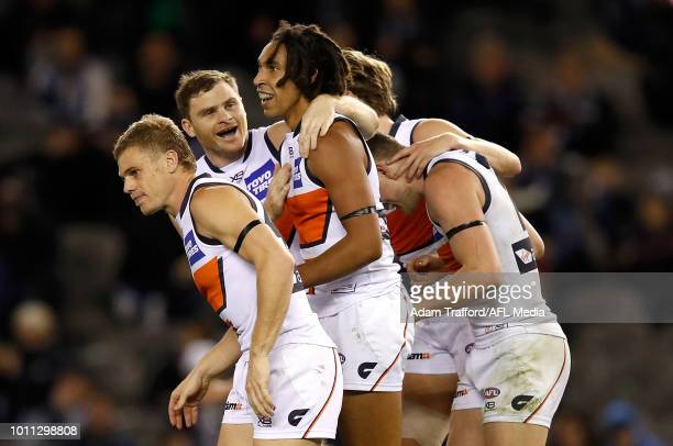 Debutant Aiden Bonar of the Giants celebrates his second AFL goal with teammates during the 2018 AFL round 20 match between the Carlton Blues and the...