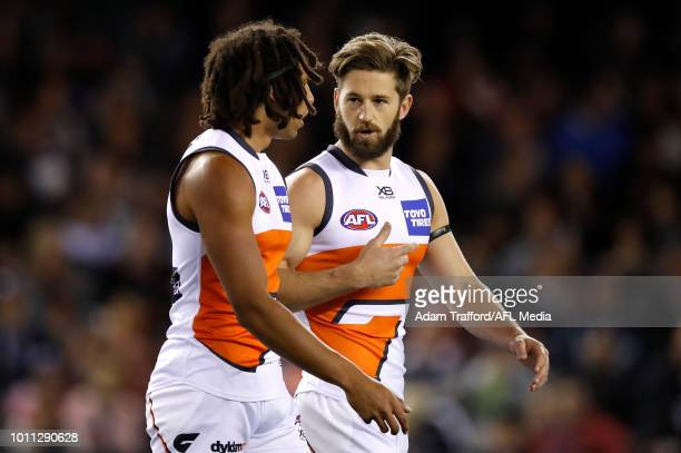 Debutant Aiden Bonar of the Giants chats to captain Callan Ward of the Giants before the match during the 2018 AFL round 20 match between the Carlton...