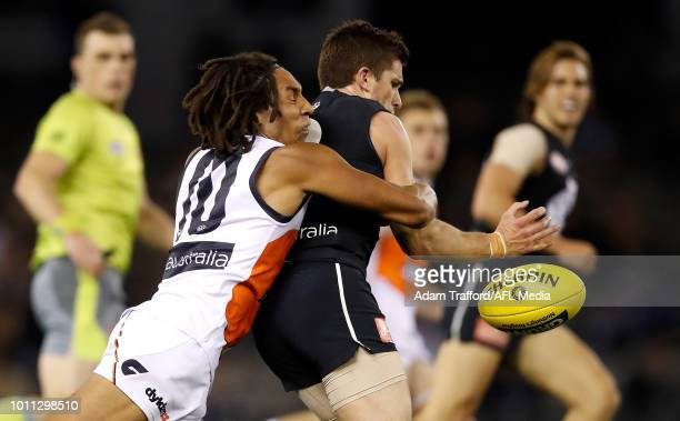 Debutant Aiden Bonar of the Giants tackles Marc Murphy of the Blues during the 2018 AFL round 20 match between the Carlton Blues and the GWS Giants...