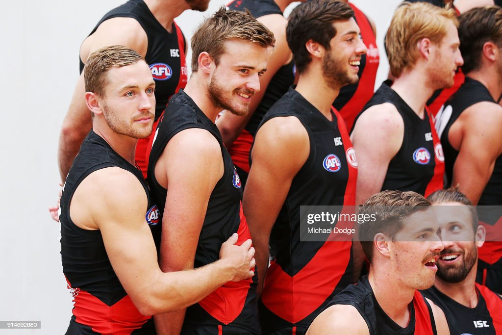 Debutant Devon Smith (L) hugs Martin Gleeson during an Essendon Bombers media session at The Hangar on February 6, 2018 in Melbourne, Australia.