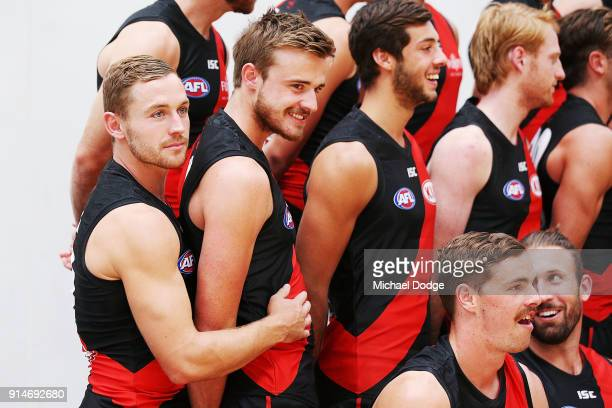 Debutant Devon Smith hugs Martin Gleeson during an Essendon Bombers media session at The Hangar on February 6 2018 in Melbourne Australia