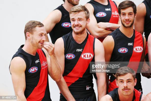 Debutant Devon Smith reacts with Martin Gleeson during an Essendon Bombers media session at The Hangar on February 6 2018 in Melbourne Australia