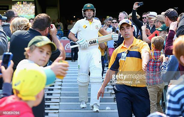Debutant Joe Burns of Australia walks out to bat during day one of the Third Test match between Australia and India at Melbourne Cricket Ground on...