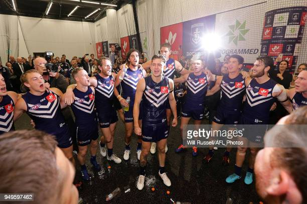 Debutant Taylin Duman of the Dockers sings the team song after the teams winduring the round five AFL match between the Fremantle Dockers and the...