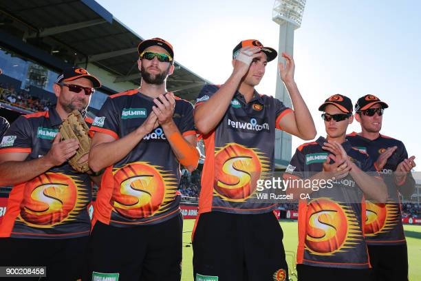 Debutant Tim David of the Scorchers is presented with his cap by Adam Gilchrist during the Big Bash League match between the Perth Scorchers and the...