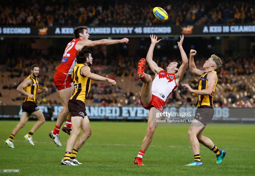 Debutant, Tom McCartin of the Swans and James Sicily of the Hawks compete for the ball during the 2018 AFL round eight match between the Hawthorn Hawks and the Sydney Swans at the Melbourne Cricket Ground on May 11, 2018 in Melbourne, Australia.