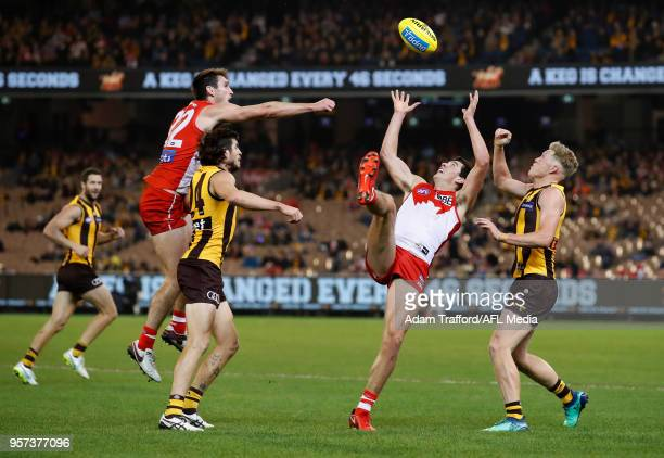 Debutant Tom McCartin of the Swans and James Sicily of the Hawks compete for the ball during the 2018 AFL round eight match between the Hawthorn...