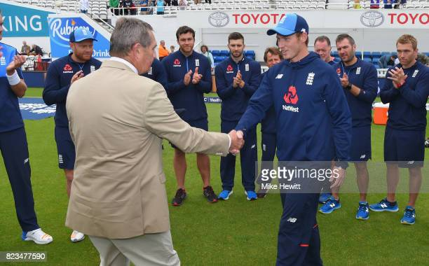 Debutant Tom Westley of England receives his cap from Graham Gooch ahead of Day One of the 3rd Investec Test between England and South Africa at The...