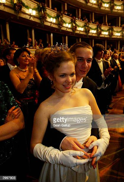 A debutante and her escort attend the Vienna Opera Ball at the city's opera house February 19 2004 in Vienna Austria