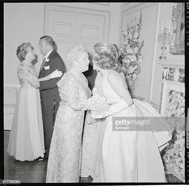 Debutante Anne Ford 18 is congratulated by her grandmother Mrs James F McDonnell Sr of New York at debut ball 6/19 at the Fords' home Her father...