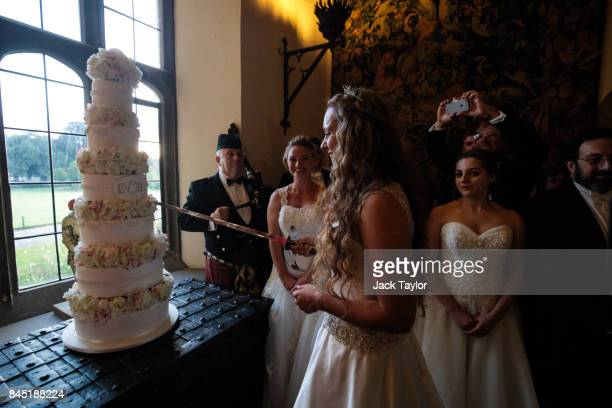 Debutante Eliza Lewis 17 from Kent who was named Debutante of the Year cuts the cake with a sword at Leeds Castle during the Queen Charlotte's Ball...