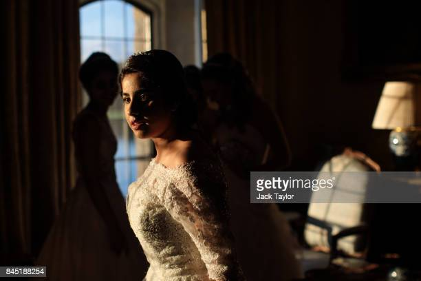 Debutante Fatima Khan from Buckinghamshire is bathed in evening light at Leeds Castle during the Queen Charlotte's Ball on September 9 2017 in...
