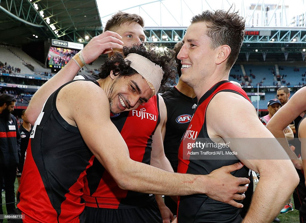 Debutante, Jake Long of the Bombers (left) celebrates with Jayden Laverde (middle) and James Polkinghorne of the Bombers of the Bombers during the 2016 AFL Round 21 match between the Essendon Bombers and the Gold Coast Suns at Etihad Stadium on August 14, 2016 in Melbourne, Australia.