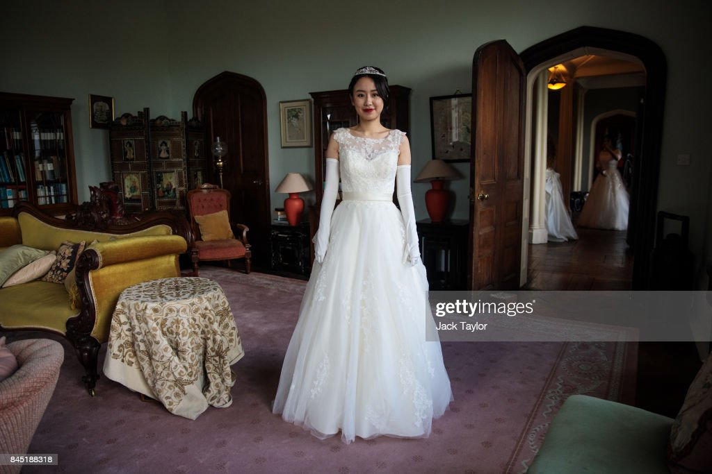 Debutante Jiabao Cui, 24, from Beijing, poses at Boughton Monchelsea Place ahead of the Queen Charlotte's Ball on September 9, 2017 in Maidstone, England. In 1780 the first debutante's Ball was held by King George III to celebrate the birthday of his wife Queen Charlotte and raised money for a maternity hospital. Society girls were presented to the monarch and it became an annual event and important as a marriage market for the upper echelons of society. The London Season runs for six months of the year including sporting events, cocktail parties, dances and concerts and the Ball is the pinnacle of this season. After the present Queen terminated the practice of introducing debutantes at royal garden parties in 1957, Lady Howard de Walden followed by then editor of Tatler, Peter Townend, continued the tradition and on his death Peter nominated former debutantes Jennie Hallam-Peel and Patricia Woodall to take over running of The London Season. It is now focussed on raising money for children in need worldwide and the Queen Charlotte's Ball has been held in Shanghai and Dubai as well as various grand venues in London. This year the debutantes' gowns have been supplied by Berketex Brides and the cake, to which the debutantes curtsey, is made by Pretty Gorgeous Cakes.