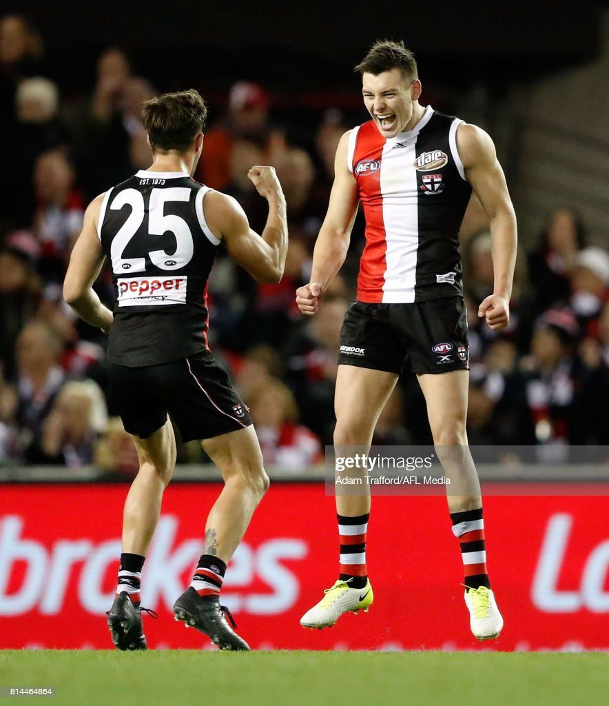 Debutante, Josh Battle of the Saints (right) celebrates his first AFL goal with Koby Stevens of the Saints during the 2017 AFL round 17 match between the St Kilda Saints and the Essendon Bombers at Etihad Stadium on July 14, 2017 in Melbourne, Australia.