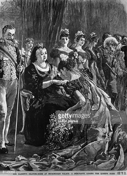 A debutante kisses the hand of Queen Victoria during her presentation in the drawing room at Buckingham Palace London Original Publication The...