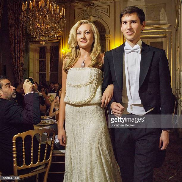 Debutante Lauren Marbe and cavalier Theodore Rousseau, of France are photographed for Vanity Fair Magazine on November 29, 2013 at the Automobile...