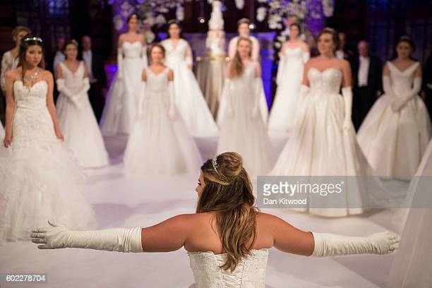 A debutante performs a dip during the Queen Charlotte's Ball at 'One Whitehall Place The Royal Horseguards Hotel' on September 10 2016 in London...