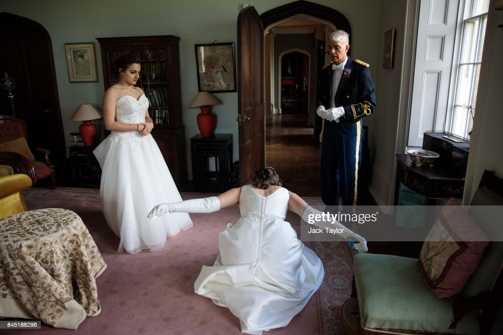 A debutante practices her dip curtsy at Boughton Monchelsea Place ahead of the Queen Charlotte's Ball on September 9, 2017 in Maidstone, England. In 1780 the first debutante's Ball was held by King George III to celebrate the birthday of his wife Queen Charlotte and raised money for a maternity hospital. Society girls were presented to the monarch and it became an annual event and important as a marriage market for the upper echelons of society. The London Season runs for six months of the year including sporting events, cocktail parties, dances and concerts and the Ball is the pinnacle of this season. After the present Queen terminated the practice of introducing debutantes at royal garden parties in 1957, Lady Howard de Walden followed by then editor of Tatler, Peter Townend, continued the tradition and on his death Peter nominated former debutantes Jennie Hallam-Peel and Patricia Woodall to take over running of The London Season. It is now focussed on raising money for children in need worldwide and the Queen Charlotte's Ball has been held in Shanghai and Dubai as well as various grand venues in London. This year the debutantes' gowns have been supplied by Berketex Brides and the cake, to which the debutantes curtsey, is made by Pretty Gorgeous Cakes.