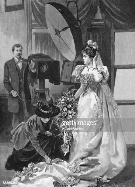 A debutante visits a photographer's studio having been presented at court 1895 She wears the obligatory short sleeved evening dress with a long train...