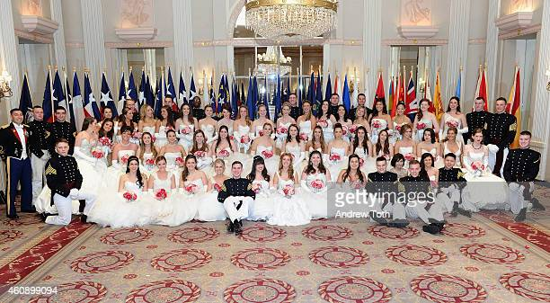 Debutantes and cadets pose for a photo during the 60th International Debutante Ball at The Waldorf=Astoria on December 29, 2014 in New York City.