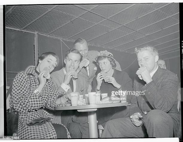 Debutantes and escorts at play at rockaway Playland, May 24, 1950- Debutantes and their escorts eating hot dogs. They are L to R Emma Davis, Russell...
