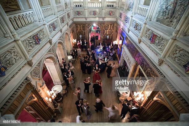 Debutantes and guests dance following their meal at the Queen Charlotte's Ball at Highclere Castle on September 13, 2014 near Newbury, England. Queen...