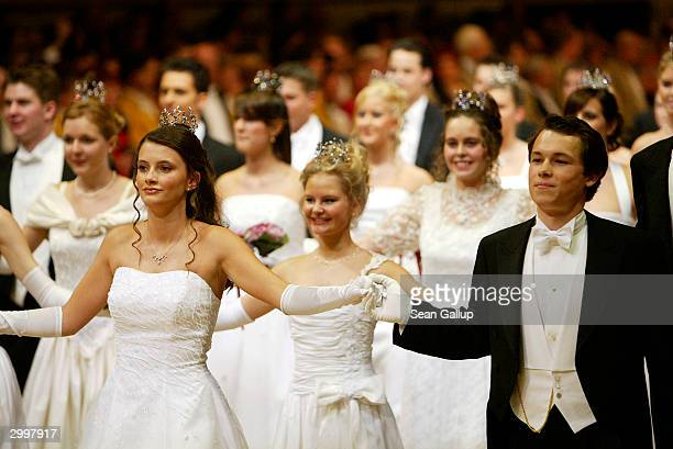 Debutantes and their escorts attend the Vienna Opera Ball at the city's opera house February 19, 2004 in Vienna, Austria.