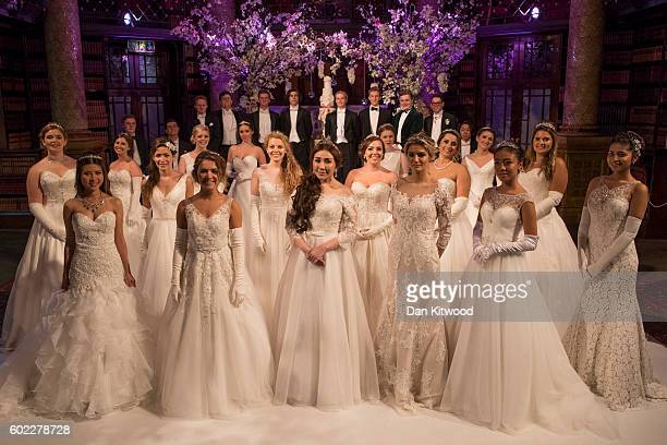 Debutantes and their escorts pose for pictures ahead of the Queen Charlotte's Ball at 'One Whitehall Place The Royal Horseguards Hotel' on September...