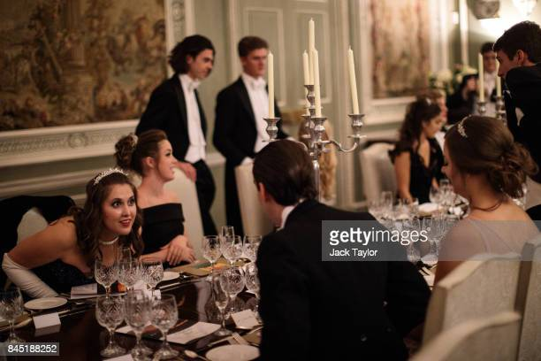 Debutantes and their escorts sit down to dinner at Leeds Castle during the Queen Charlotte's Ball on September 9 2017 in Maidstone England In 1780...