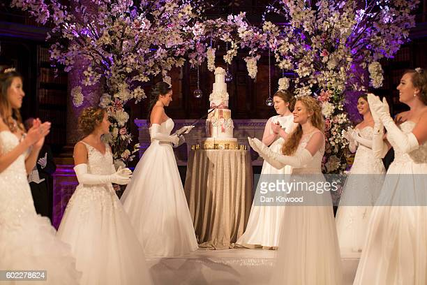 Debutantes Anna McGovern who was named Debutante of the Year cuts the cake during the Queen Charlotte's Ball at 'One Whitehall Place The Royal...