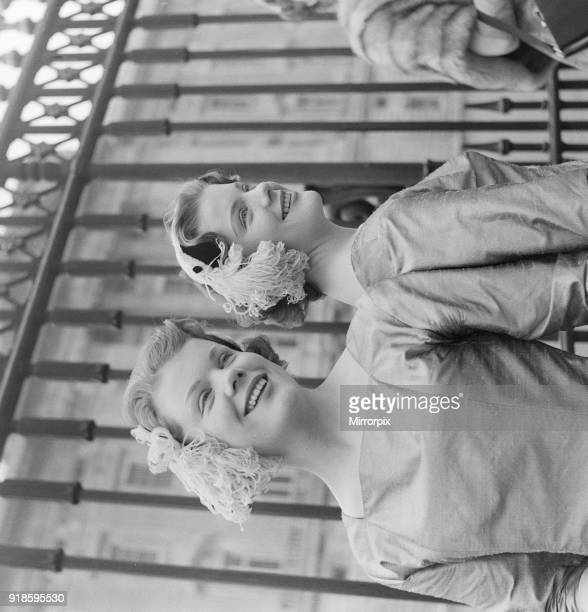 Debutantes at Buckingham Palace. Today, 500 debutantes were presented before the Queen at Buckingham Palace. Picture shows twins 18 year old Penelope...