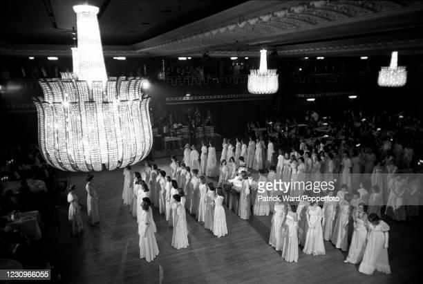 Debutantes at Queen Charlotte's Ball line up under the chandeliers at Grosvenor House, Park Lane, London, England, circa August 1976. This image is...