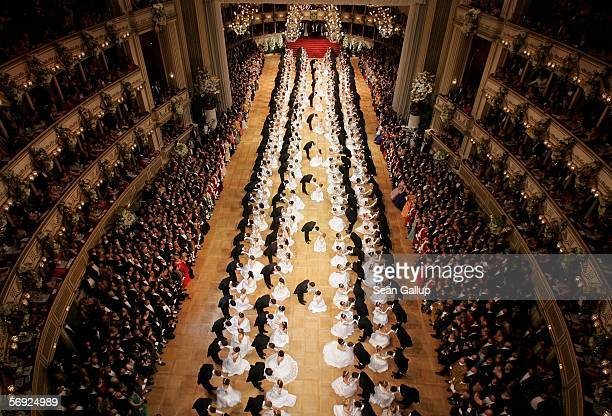 Debutantes bow to one another on the dance floor for their first waltz at the 50th Vienna Opera Ball February 23 2006 in Vienna Austria