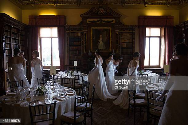 Debutantes check their seating allocation before the start of the Queen Charlotte's Ball at Highclere Castle on September 13 2014 near Newbury...