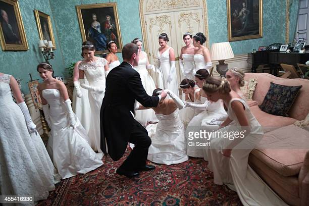 Debutantes prepare to take their places for a meal during the Queen Charlotte's Ball at Highclere Castle on September 13 2014 near Newbury England...