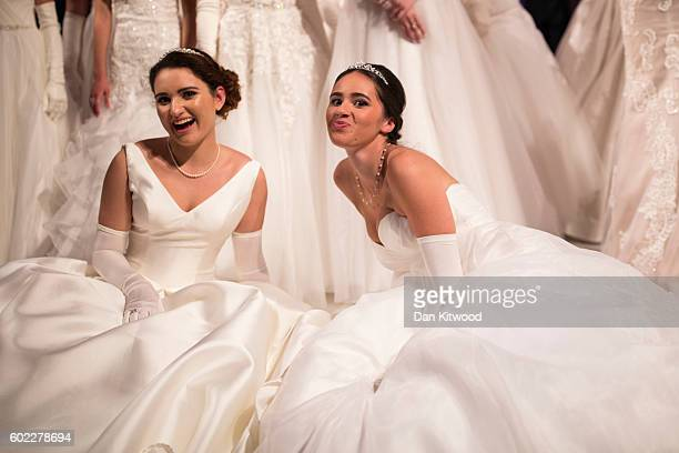 Debutantes Rebekah Sadovnikov and Anna McGovern joke while posing for pictures ahead of the Queen Charlotte's Ball at 'One Whitehall Place The Royal...
