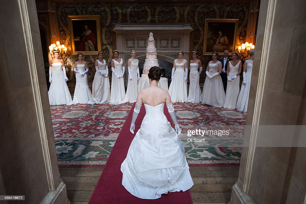 Debutantes rehearse their curtsey prior to the Queen Charlotte's Ball at Highclere Castle on September 13, 2014 near Newbury, England. Queen Charlotte's Ball is the pinnacle event in the London Season. The London Season is rich in history and was formed over two hundred years ago when the custom of returning to London at the end of the hunting season was celebrated with glittering balls and high society events. The modern group of meticulously selected debutantes continue the tradition and celebrate their year of charity fund raising, etiquette classes and debut at The Queen Charlotte's Ball. The young ladies, usually aged between 17 and 20 and wearing designer dresses, attend the grand ball where they are presented to guests and curtsey to the Queen Charlotte Cake. King George III introduced the Queen Charlotte's Ball in 1780 to celebrate his wife's birthday and debutantes were traditionally presented to the King or Queen until 1958.