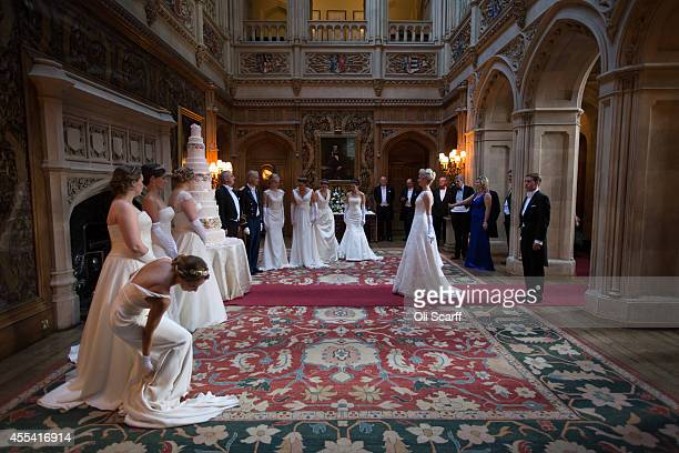 Debutantes rehearse their curtsey prior to the Queen Charlotte's Ball at Highclere Castle on September 13 2014 near Newbury England Queen Charlotte's...