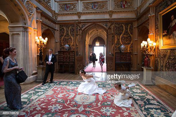 Debutantes rehearse their 'Texas Dip' curtsey prior to the Queen Charlotte's Ball at Highclere Castle on September 13 2014 near Newbury England Queen...